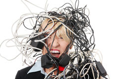 Mature businesswoman's screaming in cables. Isolated on white background Royalty Free Stock Photography