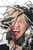 Mature businesswoman's screaming in cables. Isolated on white background Royalty Free Stock Photos