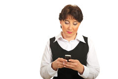 Mature businesswoman sending sms Stock Photo