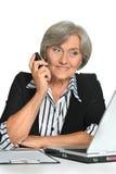 Mature businesswoman sitting Stock Image