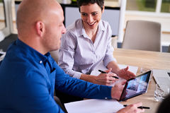 Mature businesswoman smiling at her male colleague during meeting Royalty Free Stock Photography