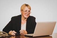 Mature businesswoman smiling Stock Image