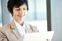 Mature businesswoman tablet computer Royalty Free Stock Photo