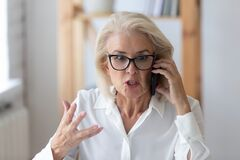Free Mature Businesswoman Talking By Phone Arguing With Client Feels Irritated Royalty Free Stock Photo - 169746765