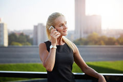 Mature businesswoman talking on mobile Royalty Free Stock Photo