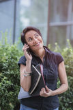 Mature businesswoman talking over her cell phone Royalty Free Stock Photo