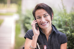 Mature businesswoman talking over her cell phone Royalty Free Stock Image