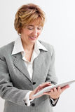 Mature  Businesswoman using Digital Tablet Stock Photo