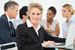 Mature Businesswoman Using Laptop Royalty Free Stock Image