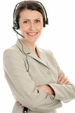Mature businesswoman wearing headset Stock Images