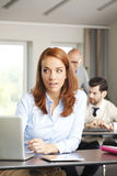 Mature businesswoman at work Royalty Free Stock Image