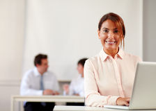 Mature businesswoman working with her laptop Royalty Free Stock Images