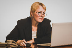 Mature businesswoman working with laptop Royalty Free Stock Photography
