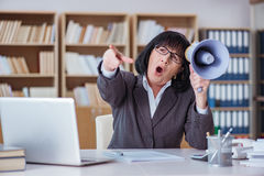 The mature businesswoman working in the office Royalty Free Stock Image