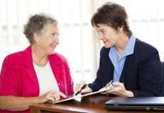Mature Businesswomen Discuss Contract Stock Image