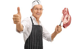 Mature butcher holding a knife Royalty Free Stock Images