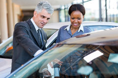 Mature car dealer african customer Royalty Free Stock Photo