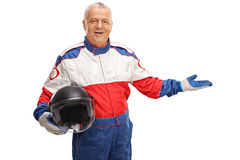 Mature car racer gesturing with his hand Royalty Free Stock Images