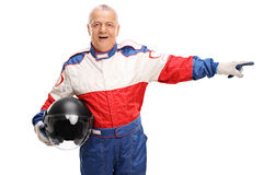 Mature car racer pointing to the right Stock Images