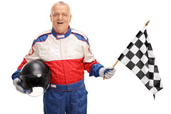Mature car racer waving a race flag Royalty Free Stock Photo
