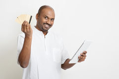 Mature casual business Indian man online payment Stock Image