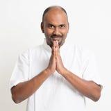 Mature casual business Indian man praying Royalty Free Stock Images