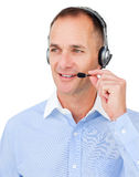 Mature Caucasian businessman using headset Royalty Free Stock Photography
