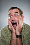 Mature Caucasian Man Elated Surprise Portrait Stock Images