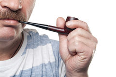 Mature caucasian man holding smoking pipe in hand Royalty Free Stock Photography
