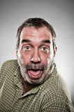 Mature Caucasian Man Sticking Out Tongue Portrait Royalty Free Stock Images