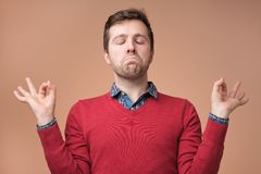 Mature caucasian man trying to relax doing meditation royalty free stock photography