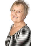 Mature caucasian woman in casual stripy top Royalty Free Stock Photography
