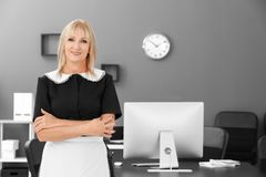 Mature charwoman in office. Mature charwoman in the office royalty free stock photo