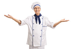 Mature chef gesturing with his hands Royalty Free Stock Photography