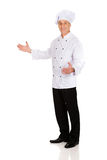 Mature chef holding empty space in hands Royalty Free Stock Image