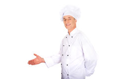 Mature chef showing copyspace on the left. Experienced smiling chef showing copyspace on the left royalty free stock images