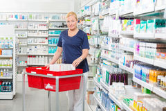 Mature Chemist With Products In Baskets At Royalty Free Stock Photo