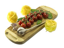 Mature Cherry tomatoes on a cutting board on a white background. Stock Images