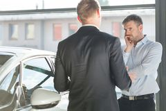 Mature client in car showroom. Photo of mature client in car showroom Royalty Free Stock Photos