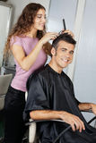 Mature Client Getting Haircut In Salon Royalty Free Stock Photo