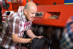 Mature cobbler polishing shoes on service machine Stock Images