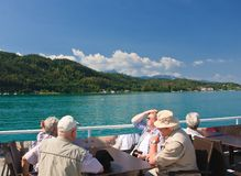 Mature company on  the ship.Worthersee. Austria Stock Images