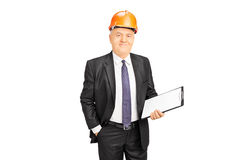 Mature construction worker holding clipboard Royalty Free Stock Photography