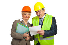 Mature constructors workers reading contract Royalty Free Stock Photo