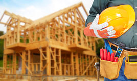 Mature contractor and frame of the cottage Royalty Free Stock Image