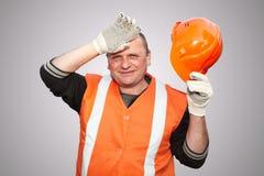 Mature contractor and helmet Stock Photo
