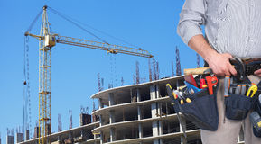 Mature contractor and hoisting crane Stock Images