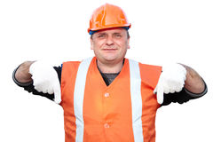 Mature contractor shows gesture Royalty Free Stock Photo