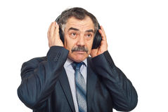 Mature corporate man listening music Stock Image