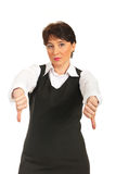 Mature corporate woman with thumbs down Royalty Free Stock Images